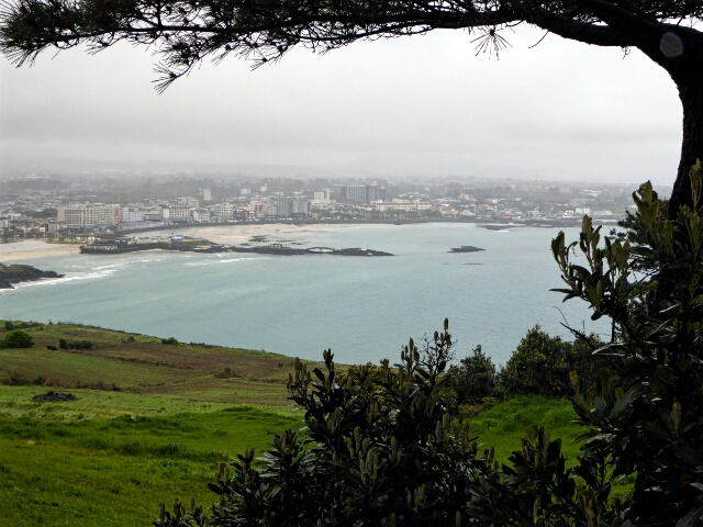 Looking back at Hamdeok Beach on a dull wet day