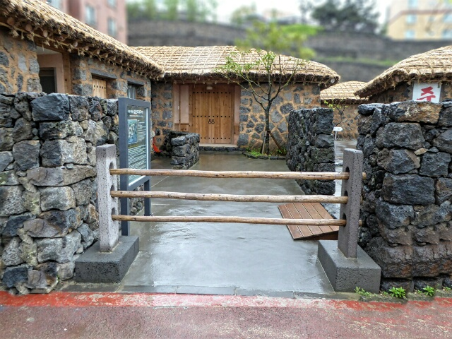 Reconstructed Jeju merchants inn of old - stone walls, straw roof - 3 poles across means we are not at home, please keep out