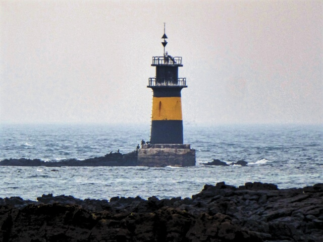 New lighthouse on a rocky coast