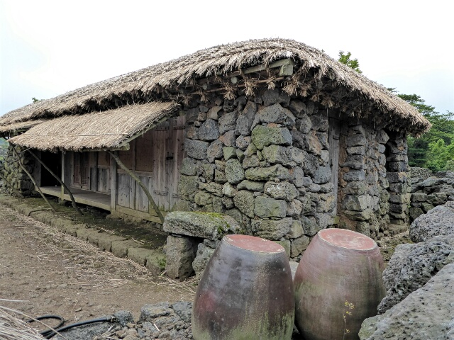 ... thatched-roof houses