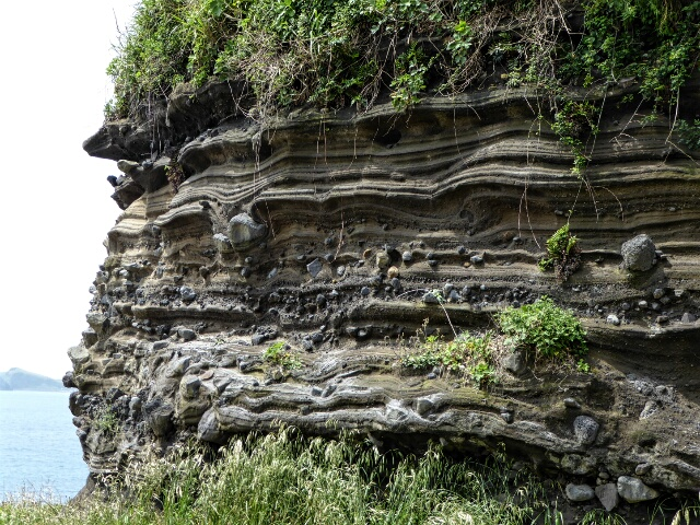 Layer by layer volcanic deposits of ash and rock