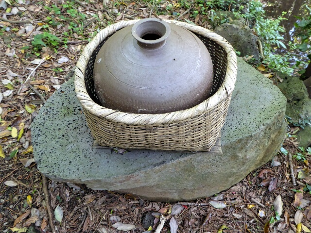 Traditional water pot and carrying basket