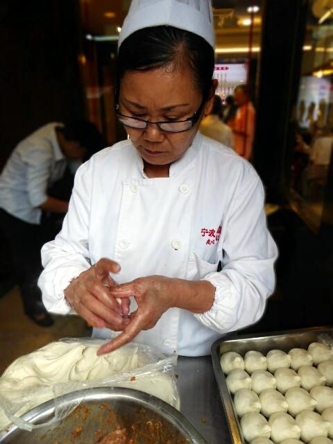 Rolling pork filled dumplings