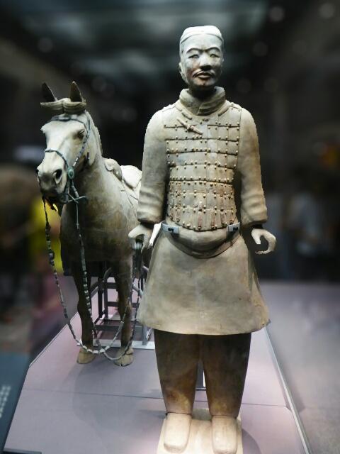 Warrior with saddled horse
