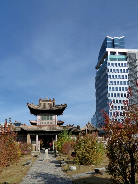 Tall modern buildings in Ulanbatar dwarf Buddhist Choijin Lama Temple