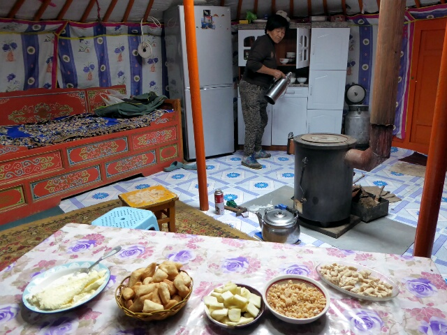 The yurt owner offers us tea and various milk products