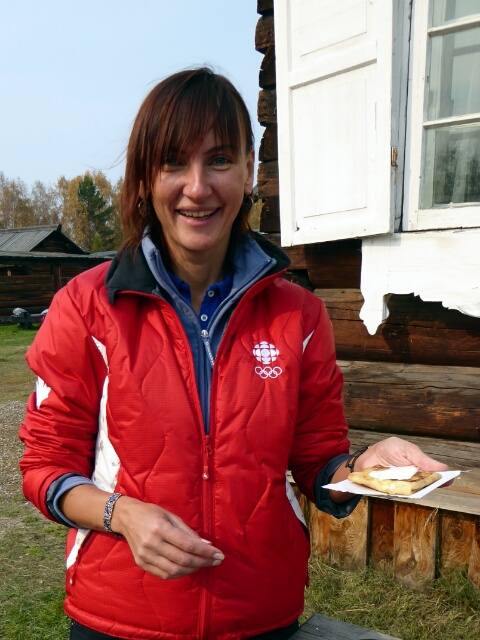 Marina, our Russian tour guide, offers a blini stuffed with farmers cheese