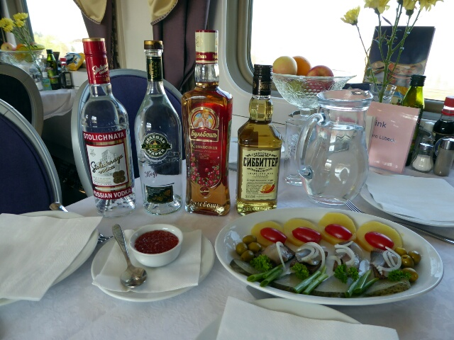 Vodka tasting on the train - 4 different vodkas, caviar and pickled herrings