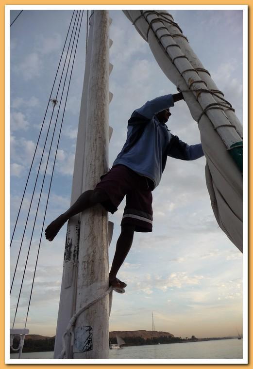 Crewman adjusting the sail