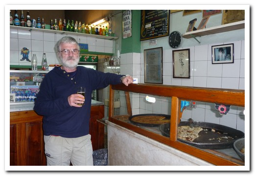 Pirilo is a tiny bar without seats, tables or plates selling 3 different types of pizza by the slice (a slice of pizza and a glass of wine costs $2).  It has been there since 1930 and is usually packed.