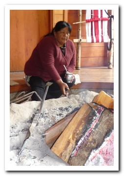 Mapuche woman by the fireplace