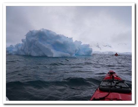 Kayaking towards an iceberg