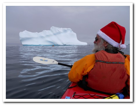 Santa arrives by kayak