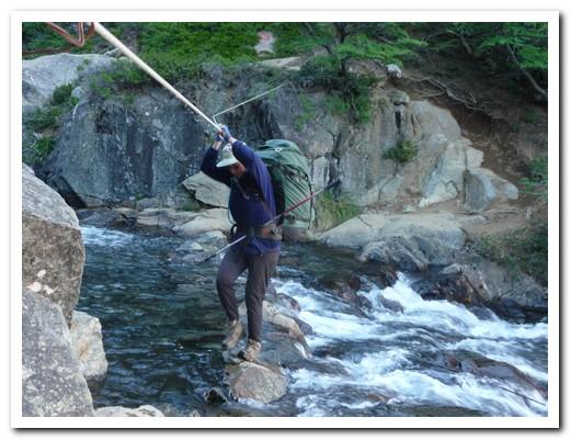 Terrified Pam crossing a waterfall