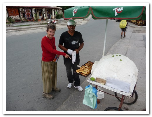 Pam choosing the empanadas from a street vendor