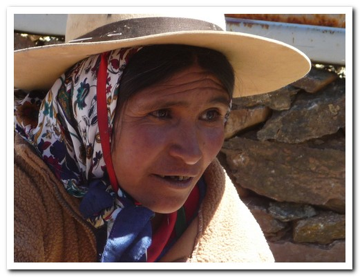 Woman selling llama wollen garments to the tourists