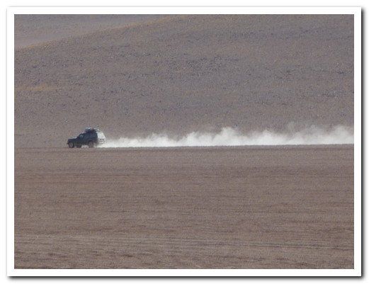 Landcruiser speeding across the desert