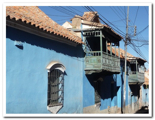 Wooden balconies overhang the cobbled streets