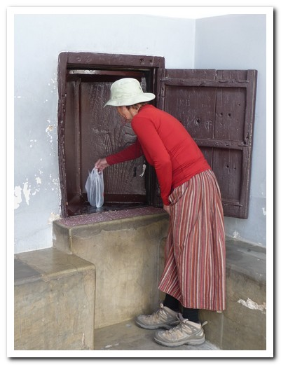 Buying sweets from the nuns through a revolving window