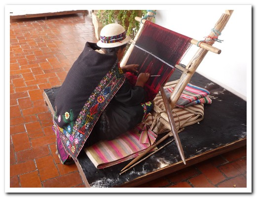 Traditional weaving (note the elaborate border around her shawl)
