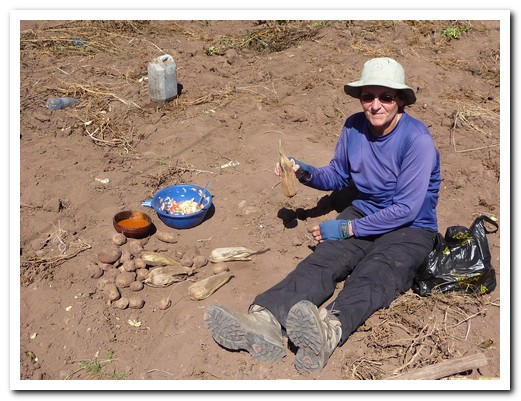 Pam enjoying the lunch cooked in the field, delicious with fresh ground chillies