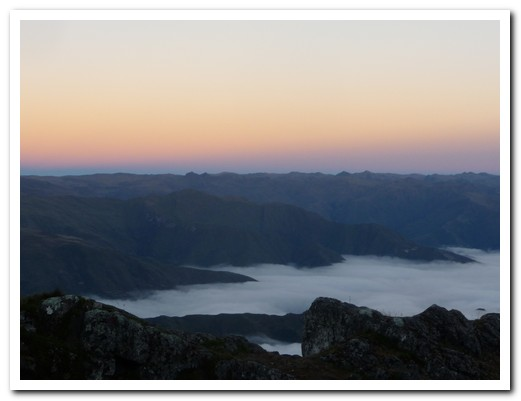 Dawn at 4200 metres, the valley below filled with cloud